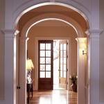 Series of arched doorways lead to a traditional foyer
